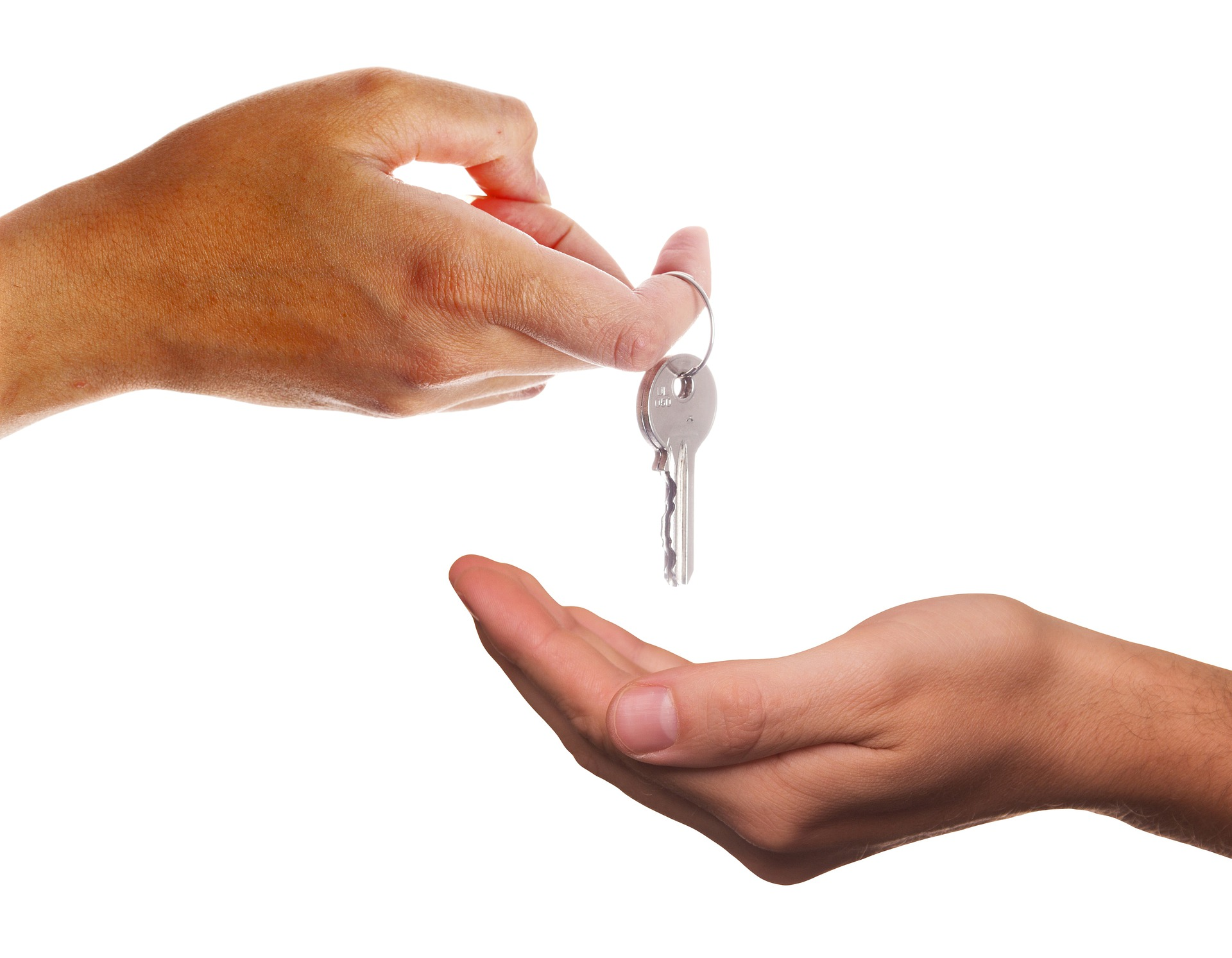 property owner giving a key to tenant